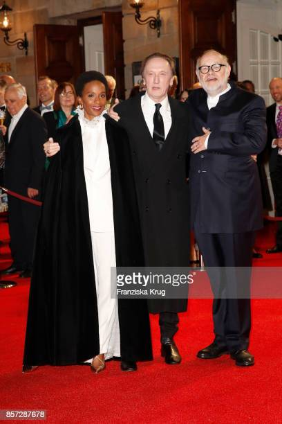 Marius MuellerWesternhagen and his partner Lindiwe Suttle and Juergen Flimm outgoing director of Staatsoper attend the ReOpening of the Staatsoper...