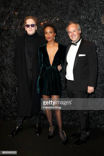 Marius MuellerWesternhagen his partner Lindiwe Suttle and Managing Director Cartier Northern Europe Renaud Lestringant attend the When the Ordinary...