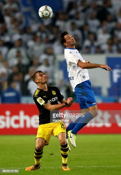 Marius Sowislo of Magdeburg and Maximilian Philipp of Dortmund battle for the ball during the DFB Cup match between 1 FC Magdeburg and Borussia...