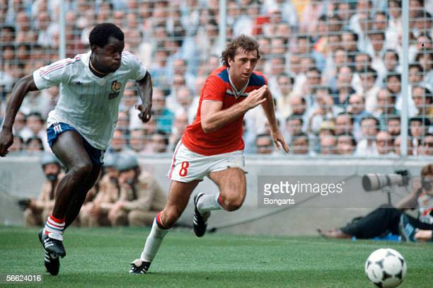 Marius Tresor of France and Trevor Francis of England in action during the World Cup match between England and France on June 16 1982 in Bilbao Spain
