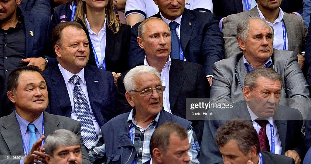 Marius Vizer of Hungary (IJF and SportAccord President), Vladimir Putin (President of Russia), Vladimir Nevzorov of Russia (1976 Olympic and 1975 World Champion) and (bottom L) Yasuhiro Yamashita of Japan (1984 Olympic and 4 times World Champion) during the Chelyabinsk Judo World Championships at the Sport Arena 'Traktor' on August 31, 2014 in Chelyabinsk, Russia.