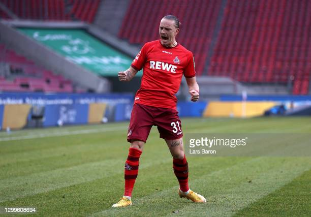 Marius Wolf of 1. FC Koeln celebrates after scoring their side's second goal during the Bundesliga match between 1. FC Koeln and DSC Arminia...