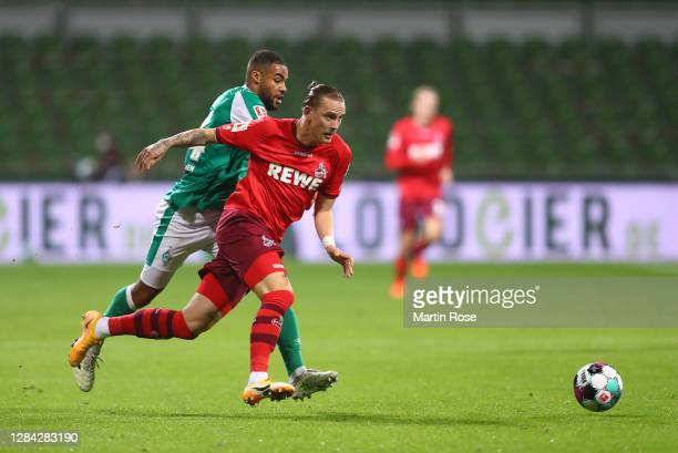Marius Wolf of 1. FC Koeln is challenged by Jean-Manuel Mbom of SV Werder Bremen during the Bundesliga match between SV Werder Bremen and 1. FC Koeln...