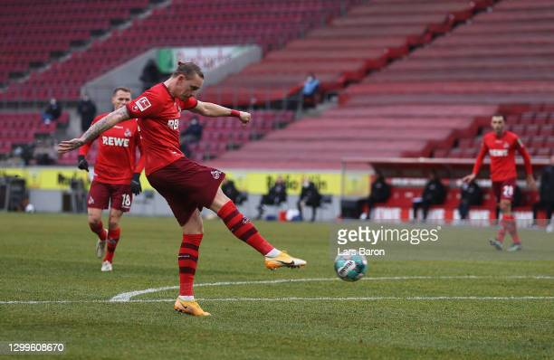 Marius Wolf of 1. FC Koeln scores their side's second goal during the Bundesliga match between 1. FC Koeln and DSC Arminia Bielefeld at...