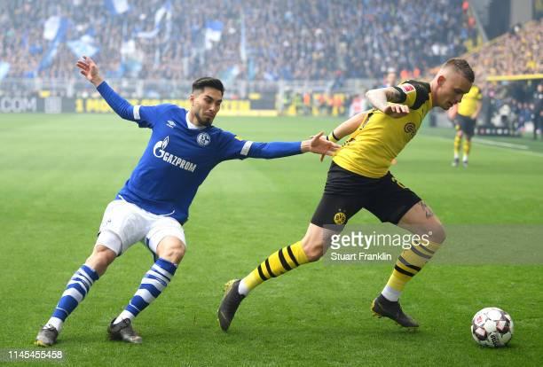 Marius Wolf of Borussia Dortmund battles for possession with Suat Serdar of FC Schalke 04 during the Bundesliga match between Borussia Dortmund and...