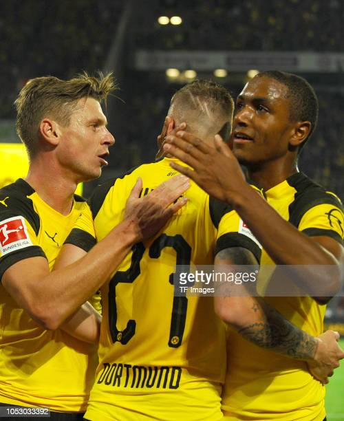 Marius Wolf of Borussia Dortmund celebrates after scoring his team`s second goal with Lukasz Piszczek of Borussia Dortmund and Abdou Diallo of...