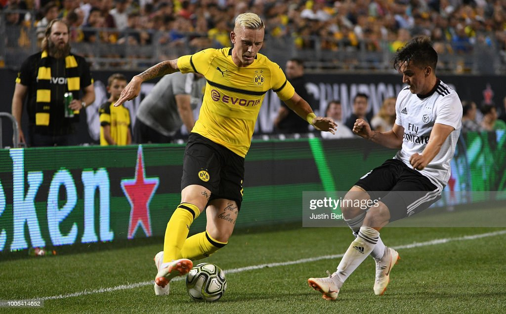 Marius Wolf #27 of Borussia Dortmund controls the ball against Franco Cervi #11 of Benfica in the second half during the 2018 International Champions Cup match at Heinz Field on July 25, 2018 in Pittsburgh, Pennsylvania.