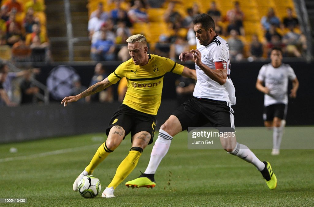 Marius Wolf #27 of Borussia Dortmund goes for the ball against Jardel #33 of Benfica in the second half during the 2018 International Champions Cup match at Heinz Field on July 25, 2018 in Pittsburgh, Pennsylvania.