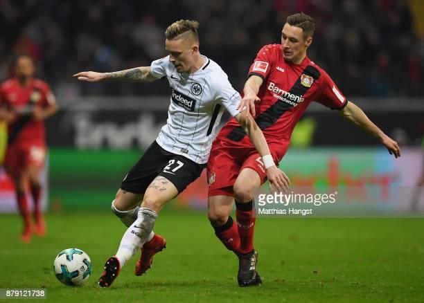 Marius Wolf of Frankfurt is challenged by Dominik Kohr of Leverkusen during the Bundesliga match between Eintracht Frankfurt and Bayer 04 Leverkusen...