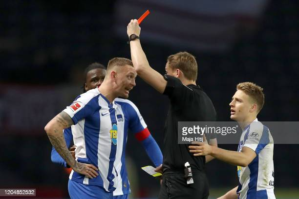 Marius Wolf of Herta BSC is shown a red card during the Bundesliga match between Hertha BSC and 1 FSV Mainz 05 at Olympiastadion on February 08 2020...