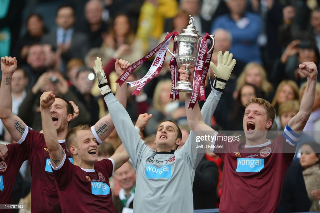 Marius Zaliuskas and Jamie MacDonald of Hearts lift the William Hill Scottish Cup after winning the William Hill Scottish Cup Final between Hibernian and Hearts at Hampden Park on May 19, 2012 in Glasgow, Scotland.