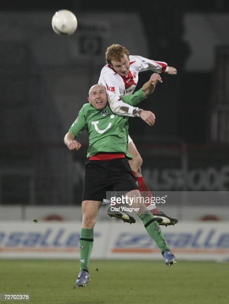 Mariusz Kukielka of Cottbus battles for the ball with Jiri Stajner of Hannover during the Bundesliga match between Energie Cottbus and Hanover 96 at...