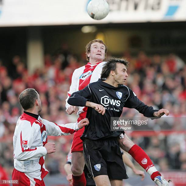 Mariusz Kukielka of Cottbus heats for the ball with Christoph Dabrowski of Bochum during the Bundesliga match between Energie Cottbus and VFL Bochum...