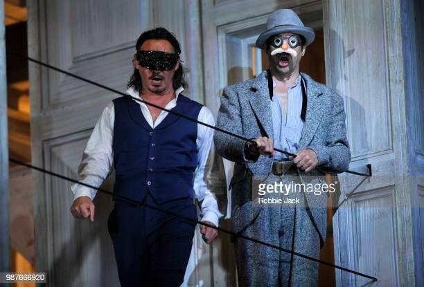Mariusz Kwiecien as Don Giovanni and Ildebrando D' Arcangelo as Leporello in the Royal Opera's production of Wolfgang Amadeus Mozart's Don Giovanni...