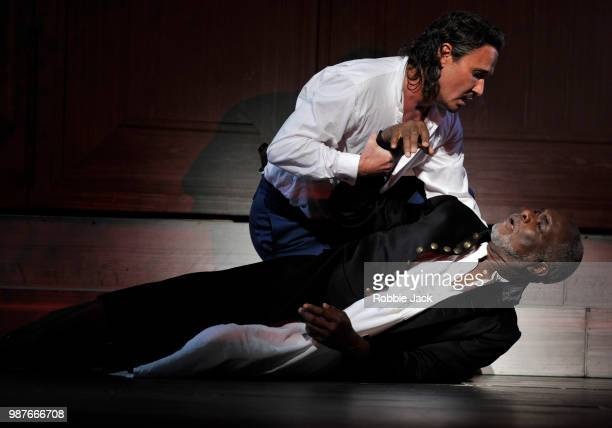 Mariusz Kwiecien as Don Giovanni and Willard W White as The Commendatore in the Royal Opera's production of Wolfgang Amadeus Mozart's Don Giovanni...