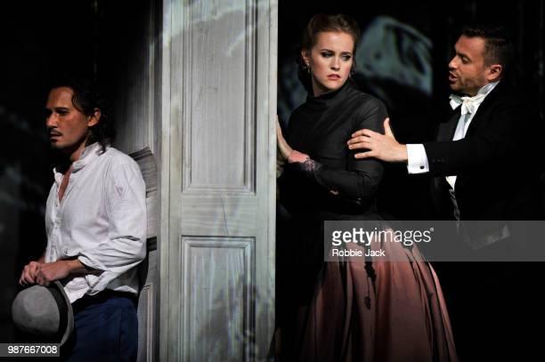 Mariusz Kwiecien as Don Giovanni Rachel WillisSorensen as Donna Anna and Pavol Breslik as Don Ottavio in the Royal Opera's production of Wolfgang...