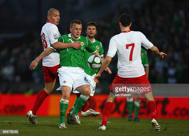 Mariusz Lewandowski of Poland tries to tackle Sammy Clingan of Northern Ireland during the FIFA2010 World Cup Qualifier match between Northern...