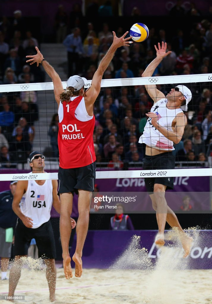 Mariusz Prudel of Poland blocks against Jacob Gibb of the United States during the Men's Beach Volleyball Preliminary match between United States and Poland on Day 3 of the London 2012 Olympic Games at Horse Guards Parade on July 30, 2012 in London, England.