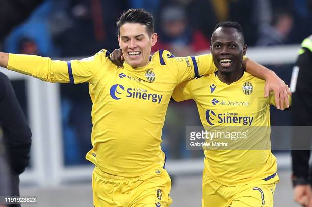 Mariusz Stepinski of Hellas Verona celebrates with Emmanuel AgyemangBadu of Hellas Verona after scoring a goal during the Serie A match between SPAL...