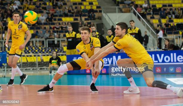 Mariusz Wlazly Bartosz Bednorz Nikolay Penchev in action during CEV Volleyball Champions League Men Round of 16 match between Skra Belchatow and...