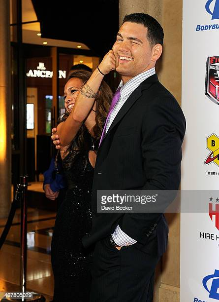 Marivi Weidman jokes around with her husband UFC Middleweight Champion Chris Weidman as they arrive at the sixth annual Fighters Only World Mixed...