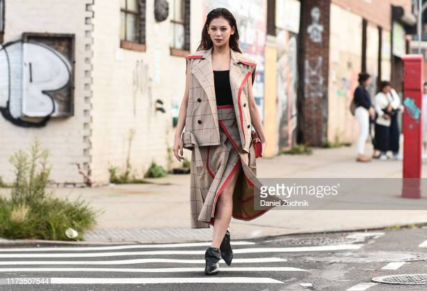 Mariya Nishiuchi is seen wearing a Phillip Lim jacket and skirt with black shoes outside the Phillip Lim show during New York Fashion Week S/S20 on...