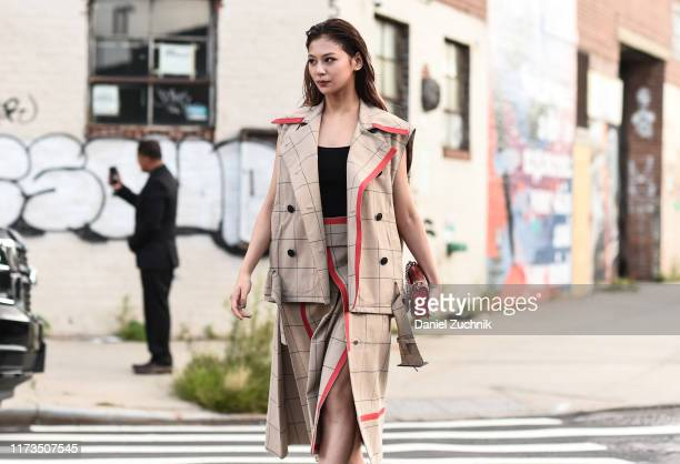 Mariya Nishiuchi is seen wearing a Phillip Limjacket and skirt with black shoes outside the Phillip Lim show during New York Fashion Week S/S20 on...