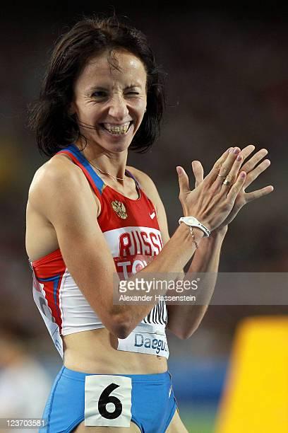Mariya Savinova of Russia celebrates victory in the women's 800 metres final during day nine of 13th IAAF World Athletics Championships at Daegu...