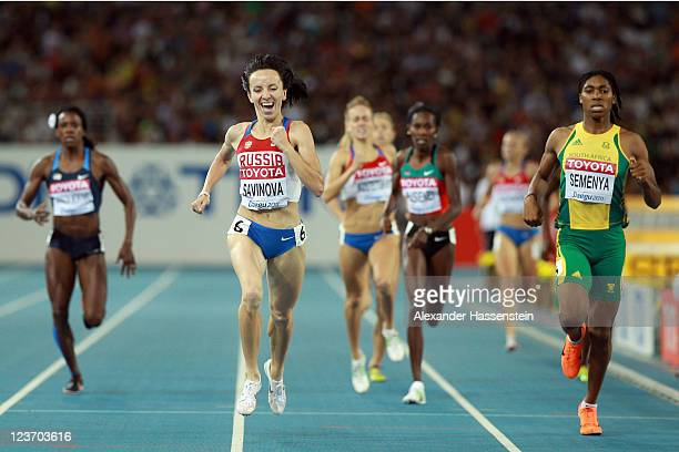 Mariya Savinova of Russia crosses the finish line ahead of Caster Semenya of South Africa to claim victory in the women's 800 metres final during day...