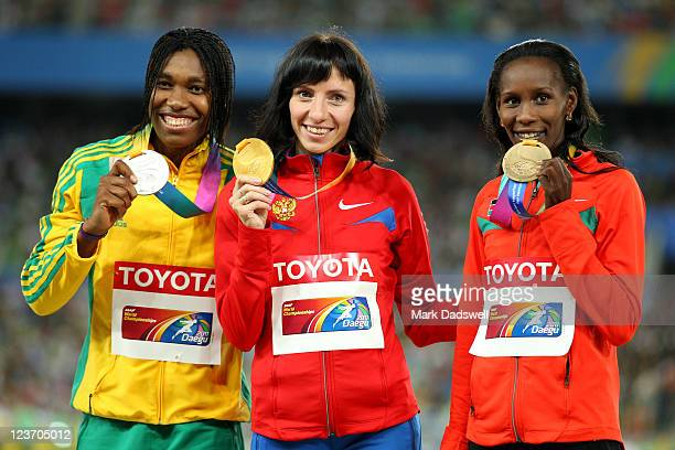 Mariya Savinova of Russia poses with her gold medal, Caster Semenya of South Africa the silver and Janeth Jepkosgei Busienei of Kenya the bronze...