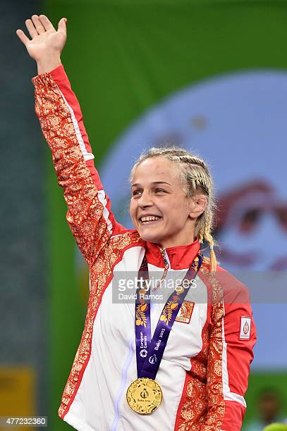 Mariya Stadnyk of Azerbaijan celebrates with her gold medal after defeating Elitsa Yankova of Bulgaria in the Women's Freestyle 48kg Wrestling Final...