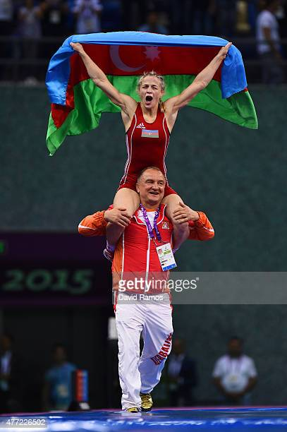 Mariya Stadnyk of Azerbaijan is carried aloft of the shoulders of her coach Simeon Shterev after defeating Elitsa Yankova of Bulgaria in the Women's...