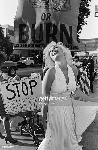 Mariyln Monroe lookalike entertains a crowd of onlookers outside the 1980 Hollywood California Adult Entertainment Awards held at the Palladium