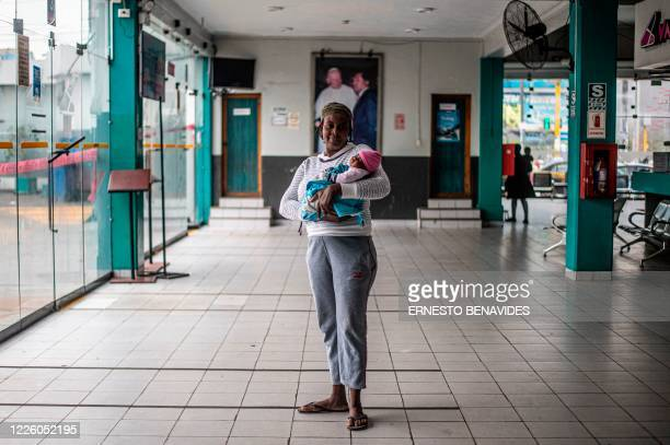 Mariyolen Narcisse poses for a picture with her daugther Sara that was born 2 month ago at the bus station in Lima on July 10 2020 On March 16 2020...
