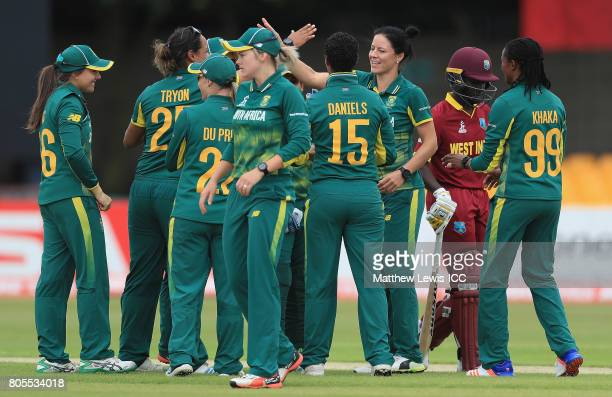 Marizanne Kapp of South Africa is congratulated on the wicket of Kyshona Knight of the West Indies after she was bowled LBW during the ICC Women's...