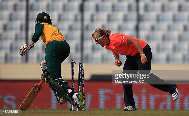 Marizanne Kapp of South Africa is run out by Charlotte Edwards of England as Danielle Hazell looks on during the ICC World Twenty20 Bangladesh 2014...