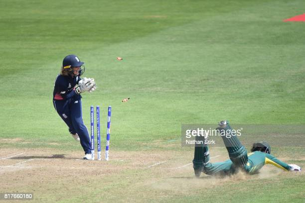 Marizanne Kapp of South Africa is run out by Sarah Taylor of England during the SemiFinal ICC Women's World Cup 2017 match between England and South...