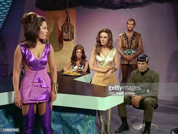 Marj Dusay as Kara far left talks to Sheila Leighton as Luma center with Leonard Nimoy as Mr Spock far right in the STAR TREK episode Spock's Brain...