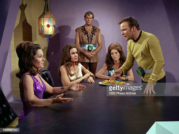 Marj Dusay as Kara far left talks to William Shatner as Captain James T Kirk far right with Sheila Leighton as Luma center in the STAR TREK episode...