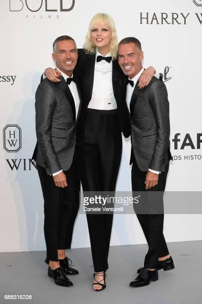 Marjan Jonkman Dan Caten and Dean Caten arrive at the amfAR Gala Cannes 2017 at Hotel du CapEdenRoc on May 25 2017 in Cap d'Antibes France