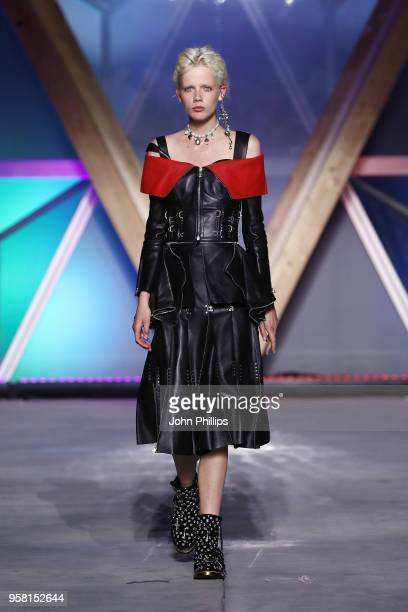 Marjan Jonkman walks the Runway at Fashion for Relief Cannes 2018 during the 71st annual Cannes Film Festival at Aeroport Cannes Mandelieu on May 13...