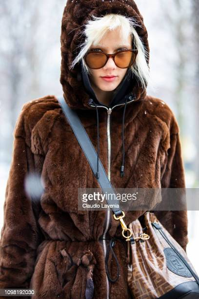 Marjan Jonkman, wearing a brown fur coat, Fendi socks, Fendi bag and black shoes, is seen outside Chanel show during Paris Fashion Week - Haute...