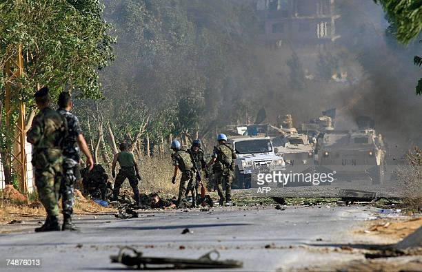 Spanish UN soldiers help their dead and wounded colleagues at the site of a roadside bomb in the southern Lebanese MarjayounKhiam valley 24 June 2007...