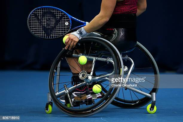 Marjolein Buis of Holland stores balls in her wheel spokes during her singles match against Diede De Groot of Holland on Day 1 of NEC Wheelchair...