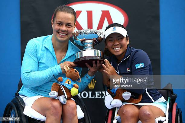 Marjolein Buis of the Netherlands and Yui Kamiji of Japan pose with the trophy after winning the Women's Wheelchair Doubles Final match against Jiske...