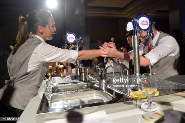 Marjolein Geuens of Belgium and Nick Kirman of the United Kingdom compete in the Stella Artois 2014 World Draught Masters Championship at the Cannes...