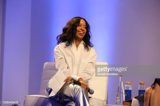 Marjon Carlos listens to other panelist at the Evian Virgil Abloh Collaboration party at Milk Studios on February 10 2020 in New York City