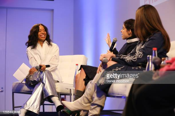 Marjon Carlos shares a laugh with other panelists at the Evian Virgil Abloh Collaboration party at Milk Studios on February 10 2020 in New York City