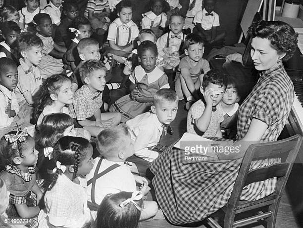 Marjorie Beach address an integrated kindergarten class after Federal courts ordered the enforcement of desegregation laws