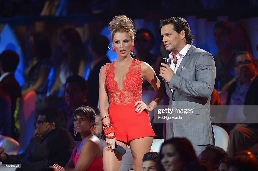 Marjorie de Sousa and Cristian de la Fuente speak onstage during the Premios Juventud 2013 at Bank United Center on July 18, 2013 in Miami, Florida.